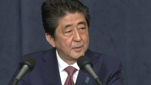 PM Abe at podium
